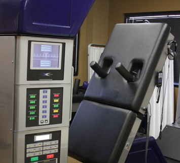 Side view of DRX 9000 Back Therapy Machine at Texas Spine Center in Houston