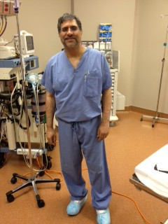 Full Image of Dr. Shah Siddiqi Spinal Surgeon / Neurosurgeon in Surgery at Texas Spine Center in Houston, TX